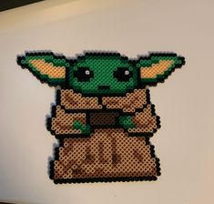 Have your own Baby Yoda! Made with mini perler beads. Perler Bead Designs, Perler Bead Templates, Diy Perler Beads, Pearler Bead Patterns, Perler Bead Art, Perler Patterns, Pokemon Perler Beads, Pearler Beads, Hama Beads Disney
