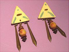 Pierced oriental earrings.  For sale!