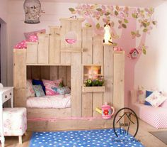 I love the pink tree and flowers on the wall.