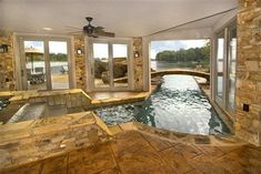 Lake House Pool with a 40' vanishing edge and a carved concrete slide modern-pool
