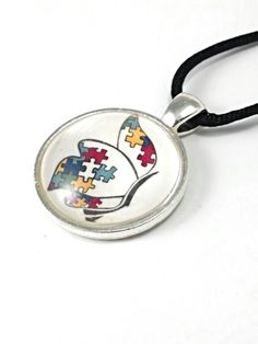 Autism awareness handmade glass Domed pendant 1 inch silver plated.  Comes with a 18-20 inch black satin necklace with lobster claw clasp. | Shop this product here: http://spreesy.com/autismgenevassky/2 | Shop all of our products at http://spreesy.com/autismgenevassky    | Pinterest selling powered by Spreesy.com