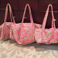 Vera Bradley pink floral travel set Vera Bradley pink floral travel set.  Tote and small duffle in great condition.  Large duffle has a hole on the side of the bag (probably 2-3 inches big) and there is wear on the handles from using it.  Other than that great shape.  Retail value was 220 dollars. Vera Bradley Bags Travel Bags