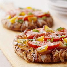 Caramelized Onion Pizza Pita bread makes a simple base for this vegetarian pizza that takes on a smoky flavor when cooked on the grill.