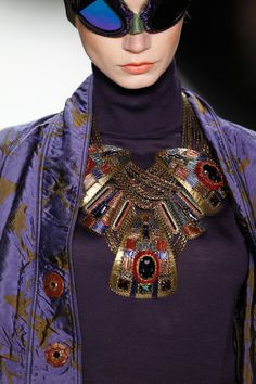 A model (Jewellery detail) walks the runway at the Miranda Konstantinidou show during Mercedes-Benz Fashion Week Autumn-Winter 2014-15 at Brandenburg Gate on January 17, 2014 in Berlin, Germany