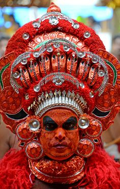 Theyyam dancer, Kerala. The lower castes of Kerala's society normally participate in Theyyam, a folklore ritual in Kerala's north as well as in bordering regions, and therefore all the stories and songs depict the cruelty of the caste system and the upper castes. Theyyam is the manifestation of God in an ordinary human being, so he or she is empowered with divine status.