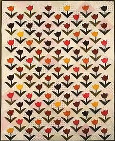 Theresa's Tulips Quilt Pattern by Primitive Gatherings at Creative Quilt Kits Stop by www.creativequiltkits.com to save 10% when you use the code- PINTEREST10