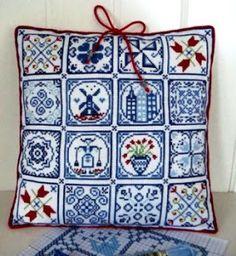 Kussen van Delftsblauwe geborduurde tegeltjes. Klik op de foto en dan scrollen om de patroontjes te vinden.