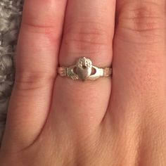 Irish Claddagh Love Ring I believe it is a size 7.  It was a gift from an ex, so it's got to go!  help me out, ladies! If you wear it as pictured, it means your heart is taken. If you wear it with the heart facing out, it means your heart is open to love. ❤️ OPEN TO OFFERS ❤️ Jewelry Rings