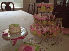 1st Birthday Smash Cake and mini cupcakes with pink whales.   overthetopcupcakes.com...i would have butterflies instead