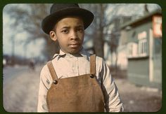 An African-American boy with black hat and brown corduroy suspenders is on a street near Cincinnati, Ohio between 1942 and 1943. Taken by FSA photographer John Vachon. Learn more about African American History and Photography, visit Digital Diaspora Family Reunion DDFR www.DDFR.tv.  The whole collection can be found in the Library of Congress. www.loc.gov/pictures/collection/fsac/  Upload and share your own family photographs and stories at ddfrsocialnet.ning.com !