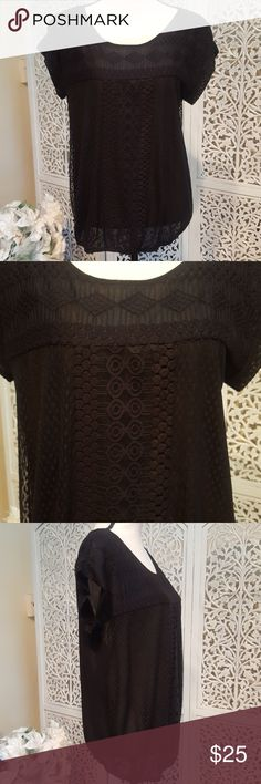 Black Textured Blouse Short sleeved black textured blouse.  This is lined but is still semi sheer. Shell: 60% nylon, 40% cotton. Contrast: 55% cotton, 45% nylon. Lining: 100% nylon. Max Studio Tops