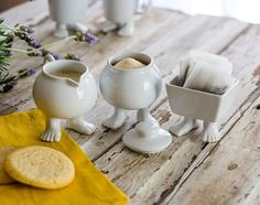 LOWER PRICE! NOW $20! START 2015 WITH A SMILE! Make coffee and tea time so much more joyful with our round creamer featuring our trademark feet.
