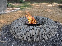 Unique Stone Fire Pits...would love to do something like this in the back yard...but I'd probably skip the metal fire dish.