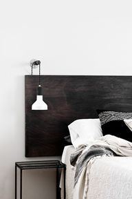 Plain and simple headboard - just one large plank. This might be nice (and easy to do) in the main or spare bedroom