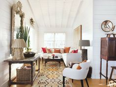 On South Carolina's popular Folly Beach, the designer refreshes a waterfront beach bungalow without sacrificing its relaxed charm