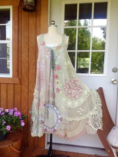 Pretty n super sweet and girlie lots of flowers and adjustable side ties so you can adjust to fit you .. Generous in size and beautiful in a light spring sage green with accents of pink mauve and flowers Fits xs-xxl