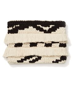 Eye-catching accessories, like this fringe embellished clutch, instantly transform a humdrum outfit. The laid-back material lends itself to both breezy summer dress and polished office attire—and the two-tone color works year-round.