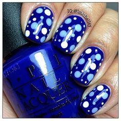 Cute blue polka dot nail design.