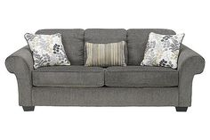 """The Makonnen - Charcoal Sofa from Ashley Furniture HomeStore (AFHS.com). The """"Makonnen-Charcoal"""" upholstery collection takes fresh contemporary design and adds the comfort of oversized rolled arms and plush seating and back cushioning all wrapped within a stylish and soft upholstery fabric creating the perfect furniture collection to complete the décor of any living space."""