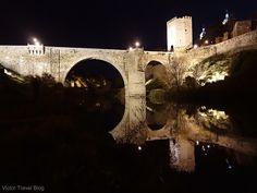 Alcantara Bridge or Puente de Alcantara at night. Toledo, Spain.