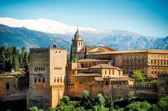 Alhambra - moorish castle with Sierra Nevada mountains covered with snow #trivo