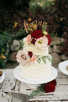 Champagne, blush and deep red wedding inspiration. Ruffled wedding cake with hooray script cake topper. http://www.theweddingguru.ca/champagne-blush-deep-red-wedding/ #blushwedding #weddingcake