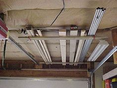 Building Inexpensive Overhead Storage For Garage Shop Or Basement With J Hooks