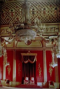 "Throne Room in Buckingham Palace, London, England -THRONES TO CHANDELIER, the Queen on the left (the proper, RIGHT)her throne says QEII on the backrest and for Phillip a ""P""."