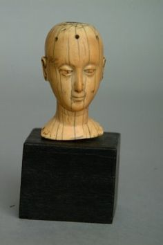 Hispano-Philippine Ivory Head, 19th c. The carved head of a female saint with six holes in the skull (once held a wig).