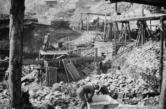 Miners work a gold placer deposit in a Klondike mining camp. Description from ritchiewiki.com. I searched for this on bing.com/images