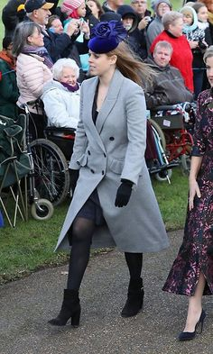 For Christmas with the Queen at Sandringham on Dec 25, Princess Beatrice wore a grey double breasted coat with ruffled details over a dark dress. The Queen's granddaughter accessorized with black booties and gloves, and a bright blue floral-motif hat.   Photo: Getty Images