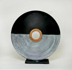 An elegant ceramic sculpture in the classic color palette bringing a sense of harmony to your home. Moby by Cheryl Williams. Ceramic Sculpture available at www.artfulhome.com
