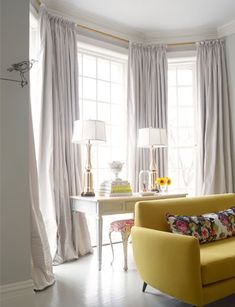 Suellen Gregory - Bay windows covered in gray silk pinch-pleat window panels curtains, ...