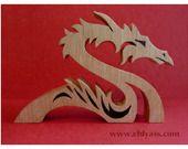 Dragon stylisé en bois massif (chantournage) : Sculptures, gravures, statues par yann-chantournage
