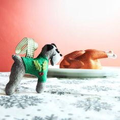 @btinahat Dex from Twitter Treats my Schnauzer Xmas Decoration to a slap up Christmas Dinner! Great entry into my festive fun competition