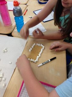 Using marshmallows on graham crackers to find area and perimeter (and even fractional parts with the graham crackers!) Picture only