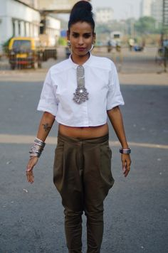 indian street fashion. silver jewelry.Jodpures. white blouse