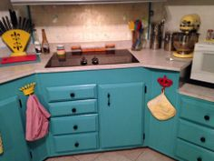 Cabinets finished with Behr Teal Zeal with pops of red and yellow!!! Happy, Happy, Happy :)