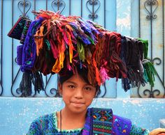 Young girl is selling sashes (like the one on her shoulder).