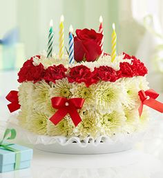 Birthday Flower Cake® Bright - cake-shaped arrangement of bright mini carnations and cushion poms in floral foam, topped with a single bright-colored rose $39.99- $79.99 #flowercake #cake #flowers