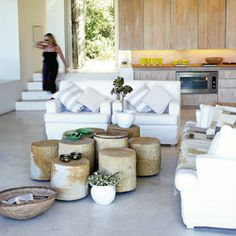 Light and airy, white upholstery, tree stumps at various heights as coffee table