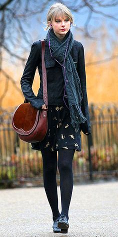 TAYLOR SWIFT Taylor really loves her Rugby Ralph Lauren saddlebag, wearing the versatile, Western-inspired style in L.A. and London.