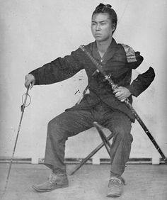Portrait of a samurai holding a muchi (whip), c.1868 Ambrotype, Boshin war era.