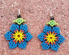 These are some Beautiful Blue Floral Flower Petal Beaded Earrings that I handmade with glass seed beads also known as Chaquira These earrings are combined with the variety of colors of Blue, Red, Orange, Light Orange, Yellow, Green, Light Green and Black. Earrings like these can definitely make a great gift for that special someone of yours. The combined beaded colors together stand out very nicely, so girly chic...  Measurements. Length: 1. 3/4 Flower Width: 1. 1/2  Please also not...