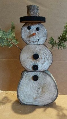 Snowman out of logs and pine boughs. Easy and fun to make.