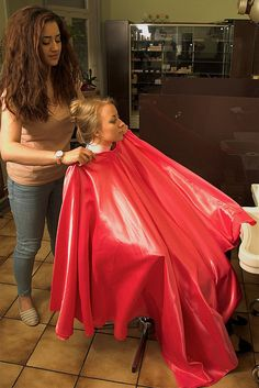 Fastening the cape before getting out the clippers....