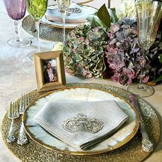 Mix Up the Place Setting | Pairs lustrous pottery plates with sterling flatware, beaded place mats, and embroidered napkins