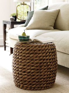 Crate & Barrel - Samar Ottoman    Exaggerated chunky weave of handwoven sustainable lampakanai fibers rounds out casual seating with high-impact texture. Sturdy cylinder-shaped ottoman also doubles as a side table or footrest.  I love texture, and great footstools!