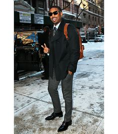 Michael B. Jordan                 On Jordan: Dolce & Gabbana coat; Viktor & Rolf pants; Coach bag; Christian Louboutin shoes.  Urbinati: The secret to pulling off a trench coat without looking like a flasher is the shorter, mid-thigh length. And the fact that he's wearing it almost as a suit jacket replacement is as cool as can be.  Williams: Michael B. Jordan looks great here. Not many can pull off the backpack with the suit, and he does it with ease.