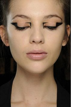 zexxy geometric eyeliner from russian vogue - I think I'd use scotch tape to make a stencil for this look